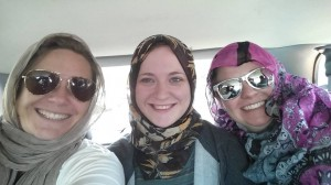 Joey Larson, Autumn Bedore, and Angela Howard are all smiles on their way to visit an Islamic mosque during their mission trip to the Twin Cities.